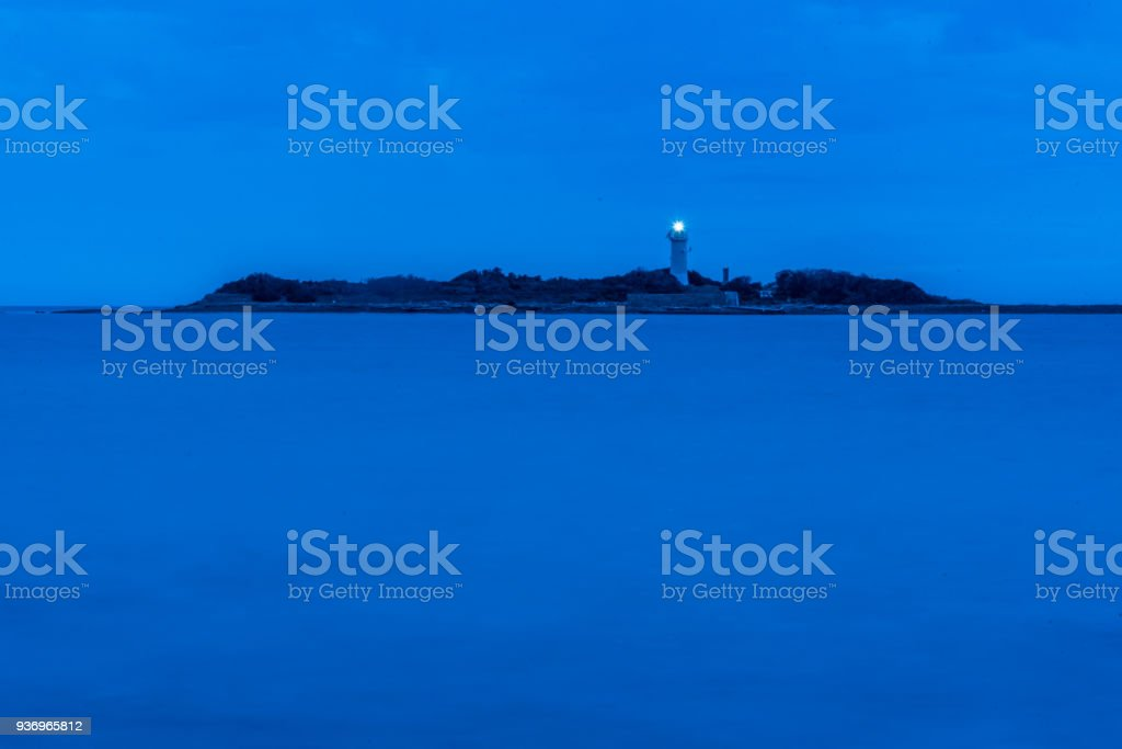 Lighthouse at Night on the Southern Mediterranean Sea Long Exposure stock photo