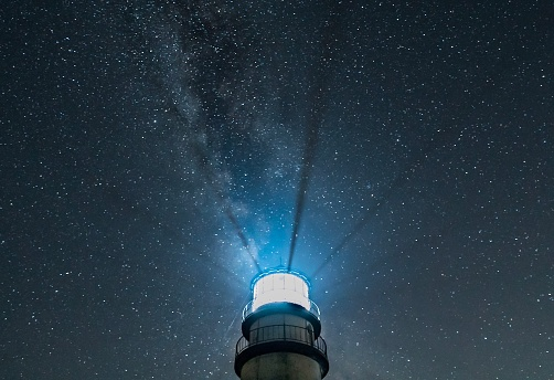 Lighthouse At Night With Radiating Beams And Starry Sky ...