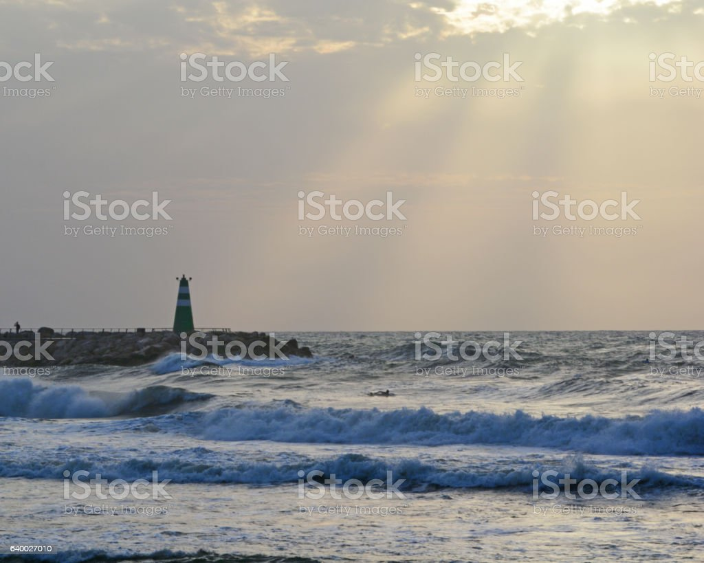 Lighthouse at Sundown stock photo