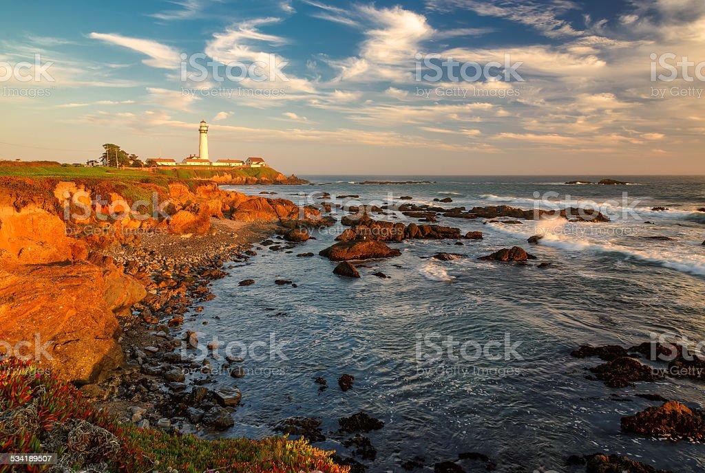 Lighthouse at sunset, Pigeon Point, California coast. stock photo