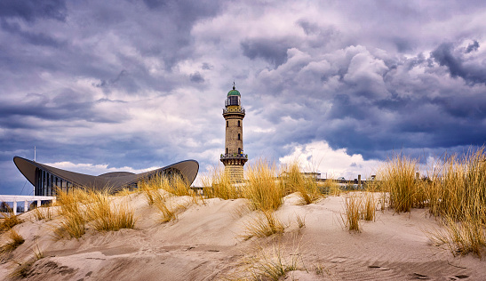 Lighthouse at the Teepott behind the dunes in Warnemünde.