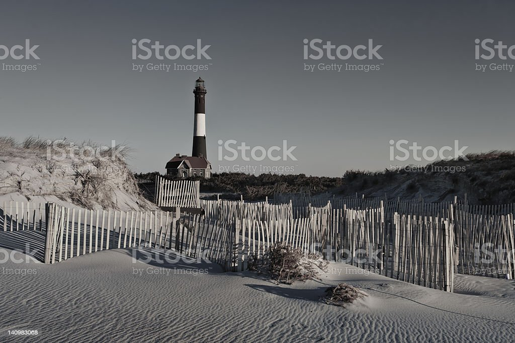 Lighthouse Beach and Fence stock photo