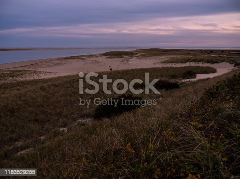 Sweeping view of rugged grassy dunes at Lighthouse or South Beach in Chatham Massachusettts