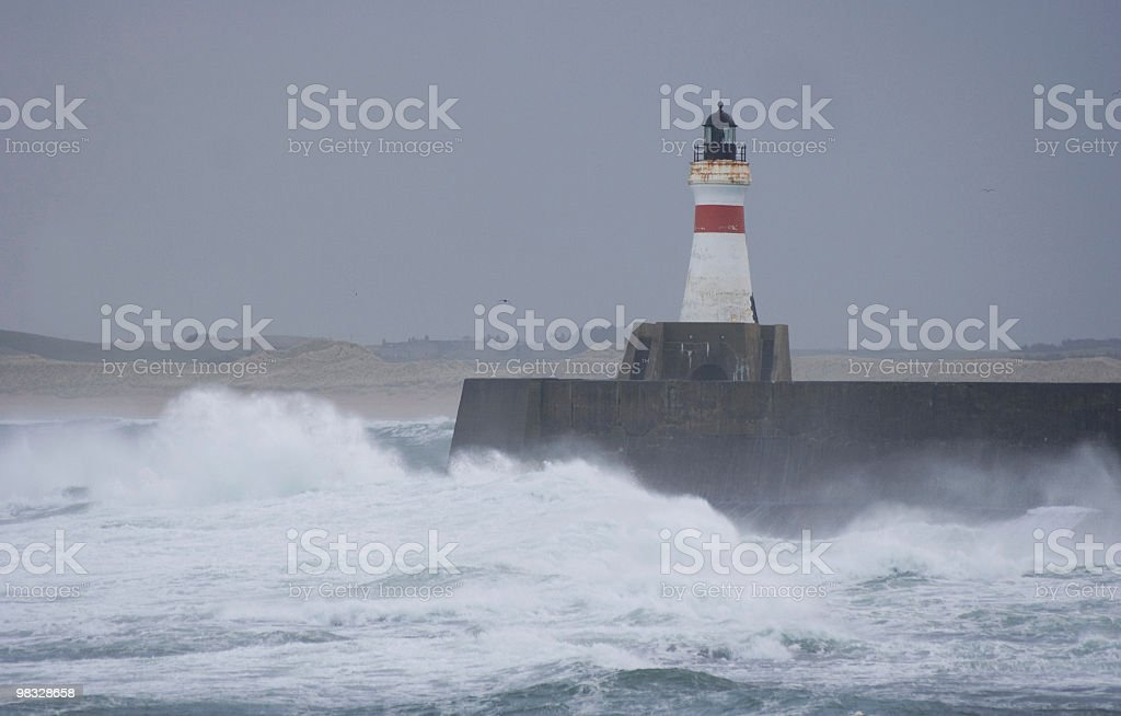 Lighthouse beacon in storm royalty-free stock photo