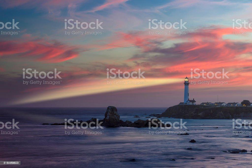 Lighthouse beam at sunset, Pacific coast, California stock photo