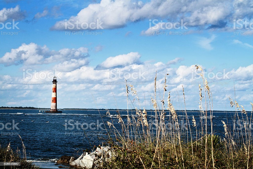 Lighthouse by the Beach stock photo
