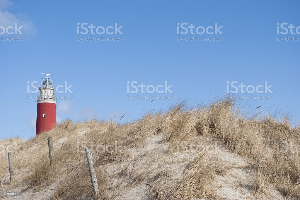 Lighthouse by the beach royalty-free stock photo