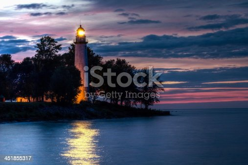 istock Lighthouse glowing in the sunset 451855317