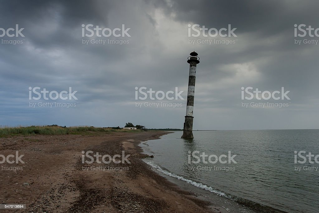 Lighthouse in Baltic Sea. Stormy night. Kiipsaar, Harilaid, Saaremaa, Estonia. stock photo