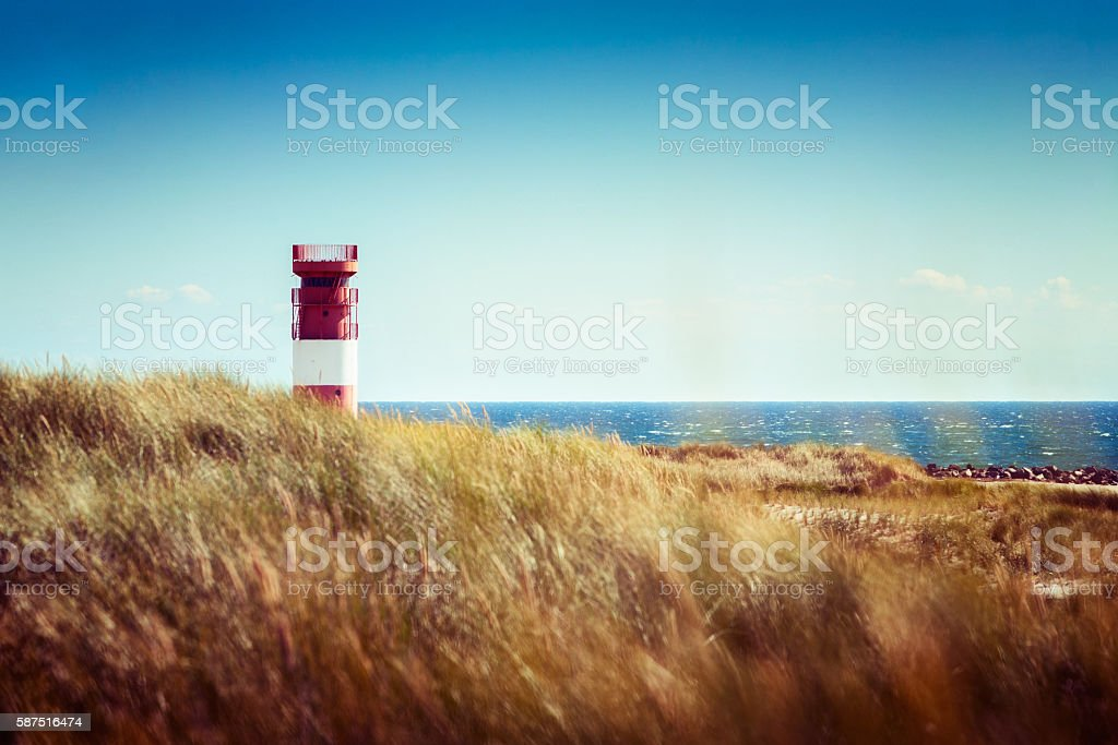 Lighthouse in dunes stock photo