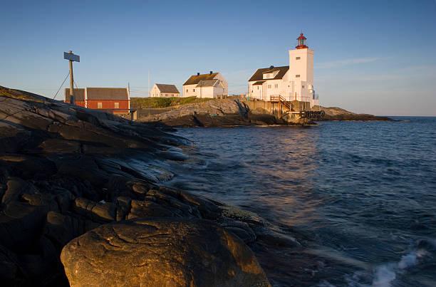 Lighthouse in evening sun. stock photo