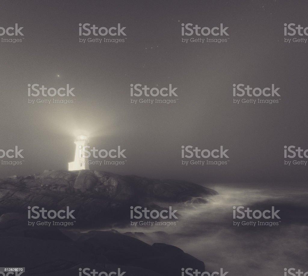 Lighthouse in Fog stock photo