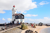 Marken, Netherlands - February 27, 2015: The Lighthouse near Marken Village. Marken is located in the municipality of Waterland in the east of the province of North Holland in the west of the Netherlands and it's a big tourist attraction.