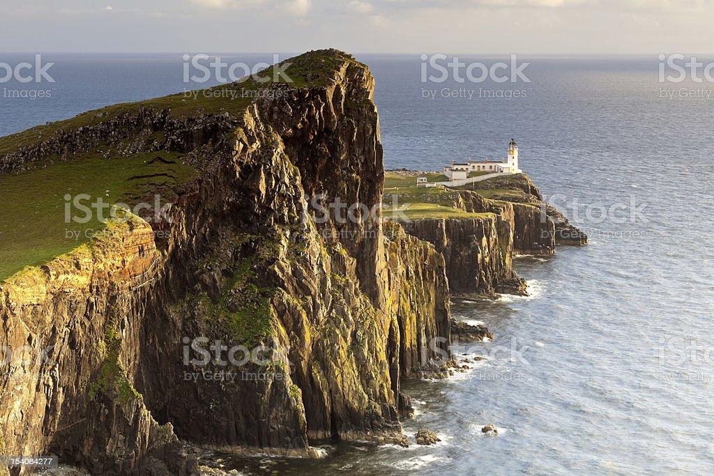 Lighthouse in Neist Point at sunset, Scotland, UK royalty-free stock photo