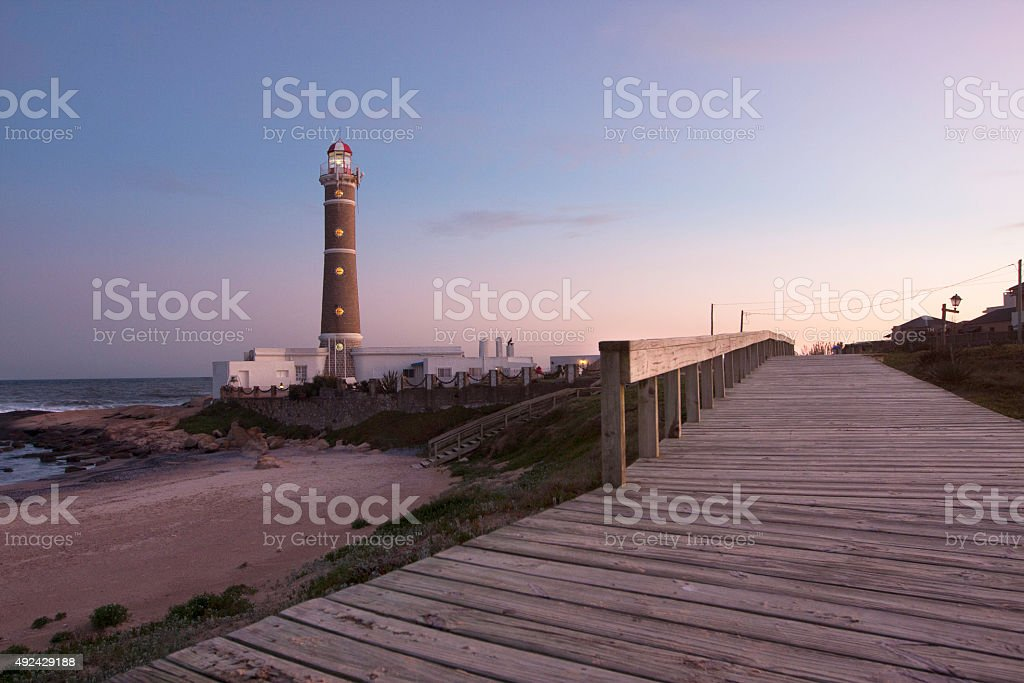 Lighthouse in Punta del Este at sunset stock photo