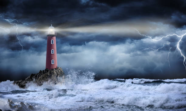 lighthouse in stormy landscape - leader and vision concept - storm stock photos and pictures