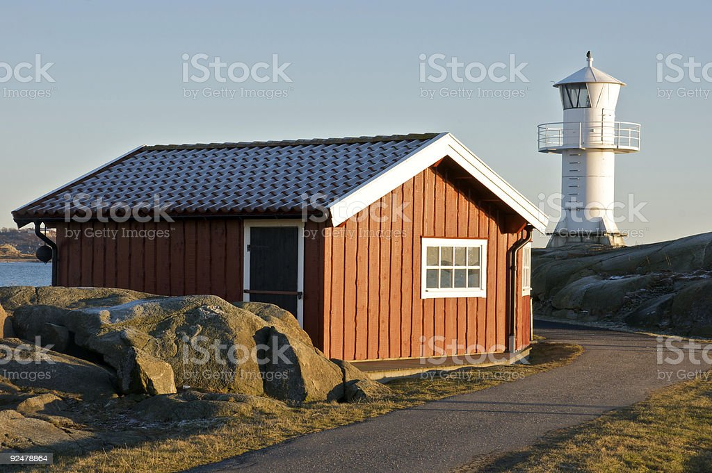 lighthouse in sunset royalty-free stock photo
