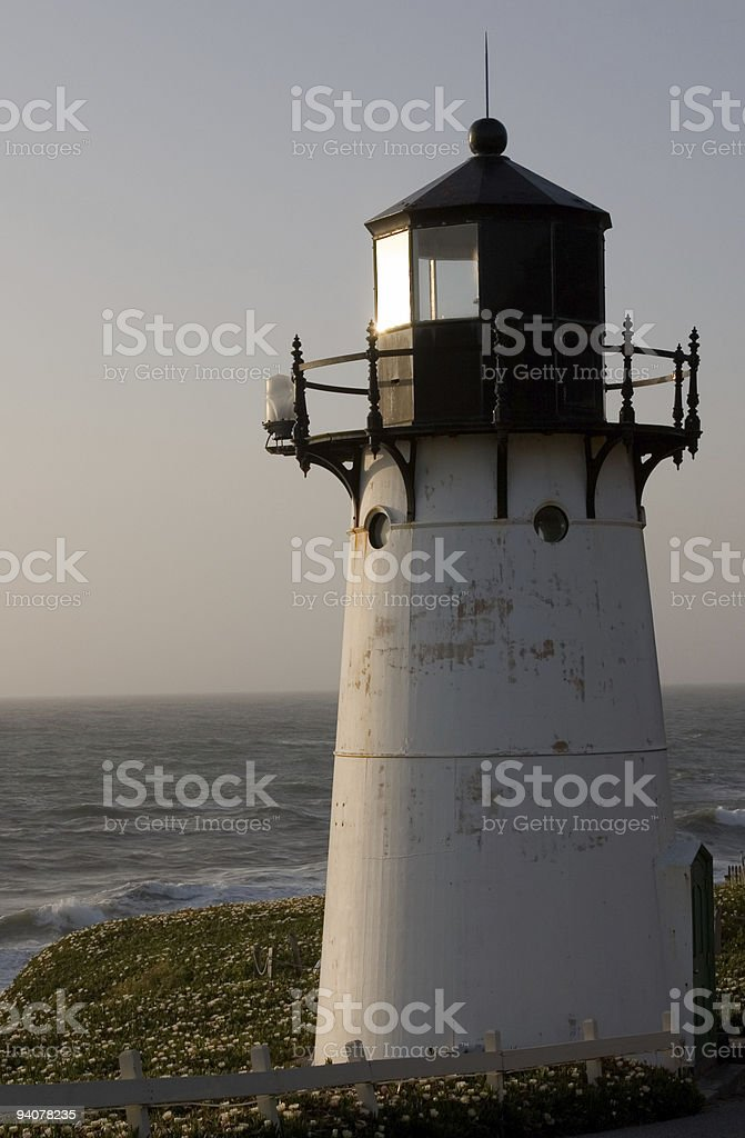 Lighthouse in sunset stock photo