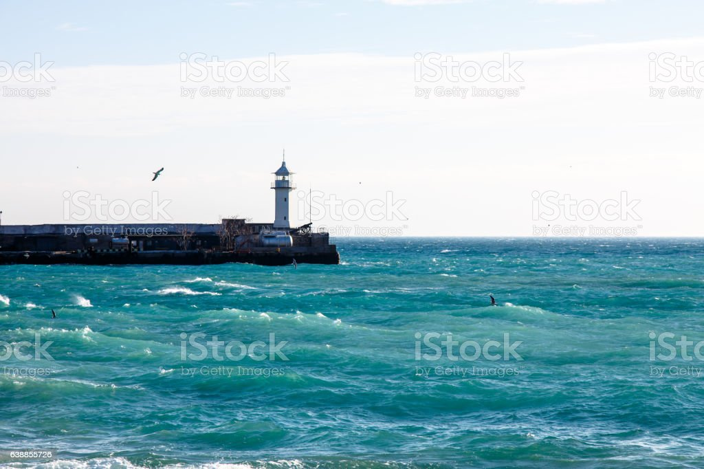 Lighthouse in the Bay stock photo