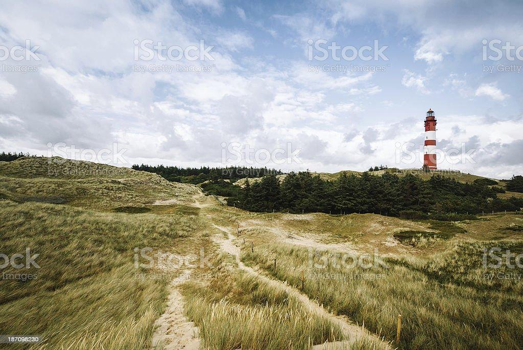 Leuchtturm in den Dünen – Foto