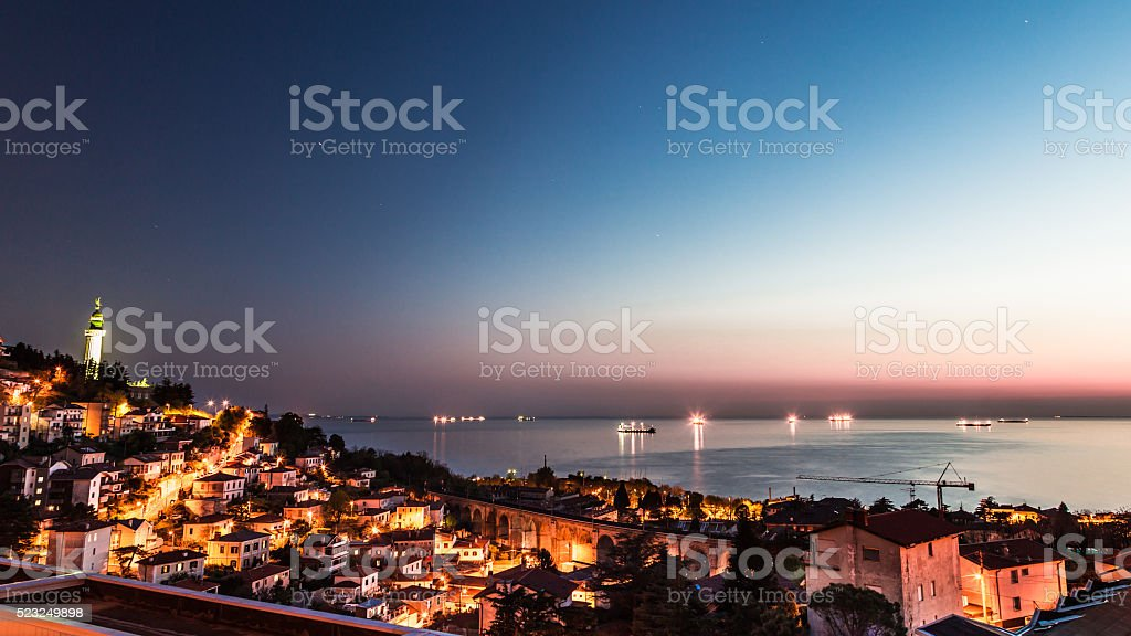 lighthouse in the evening stock photo