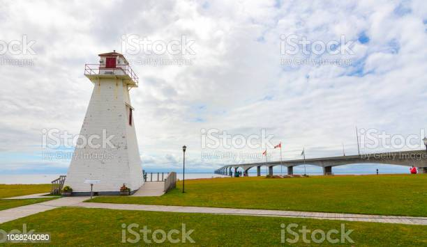 Photo of Lighthouse in the park.  Warm muggy day in PEI.  New Brunswick Confederation Bridge in distance.