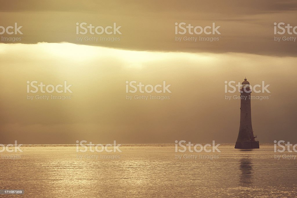 lighthouse in the sea stock photo