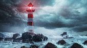 istock Lighthouse in the storm 1272648367