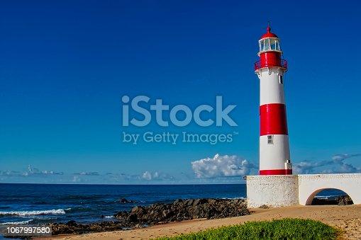 Lighthouse Itapua beach with blue sky, Salvador, Bahia, Brazil