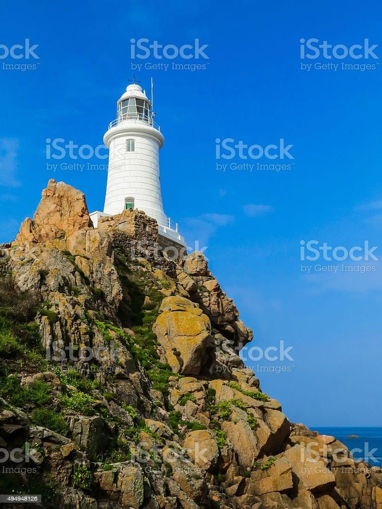 Lighthouse La Corbiere on the rock. Jersey Island, Channel Islands stock photo