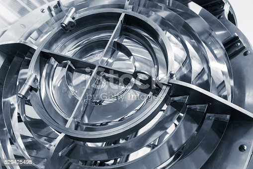 172424642 istock photo Lighthouse lamp with glass rings, blue toned 529425498