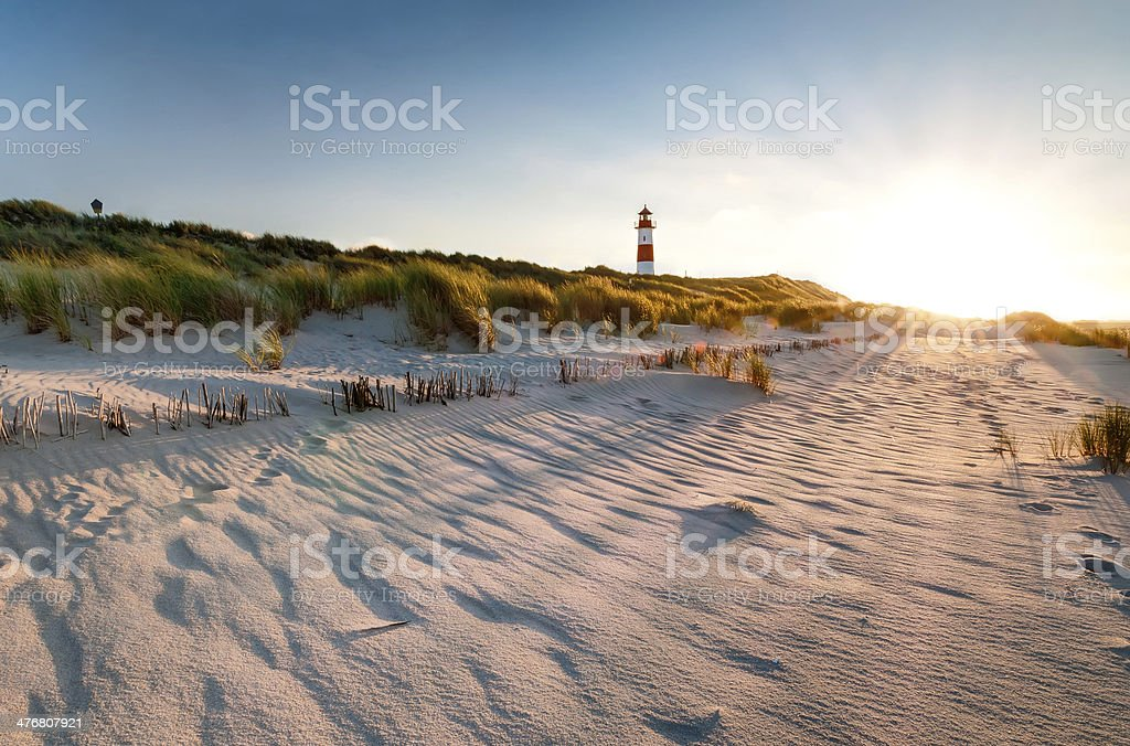 Lighthouse List East with Sunbeams stock photo