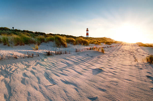 lighthouse list east with sunbeams - denmark stock photos and pictures