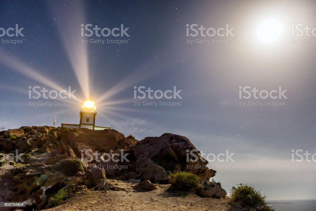 Lighthouse & moon stock photo