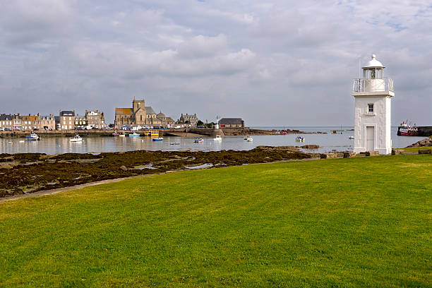 Lighthouse of Barfleur in France White lighthouse and church of Saint-Nicolas in the background of Barfleur, a commune in the peninsula of Cotentin in the Manche department in Lower Normandy in north-western France cherbourg stock pictures, royalty-free photos & images