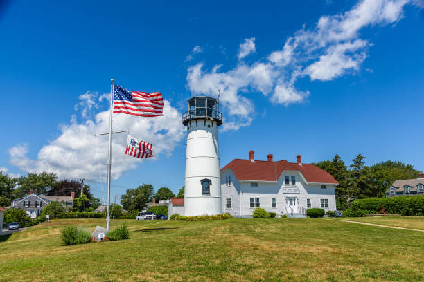 Lighthouse of Chatham The lighthouse of Chatham and the american flag waving artistical stock pictures, royalty-free photos & images