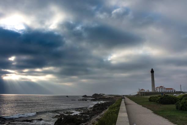 lighthouse of leça da palmeira, a cloudy day - rain clouds porto portugal imagens e fotografias de stock