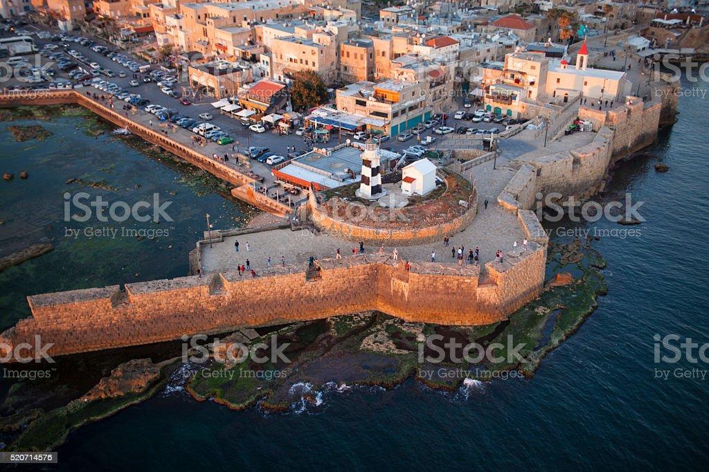 Lighthouse of old port of Akko, Israel. stock photo