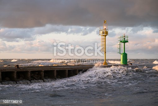 The lighthouse on a breakwater of the town of Cesenatico on a summer evening sunset. Emilia Romagna, Italy