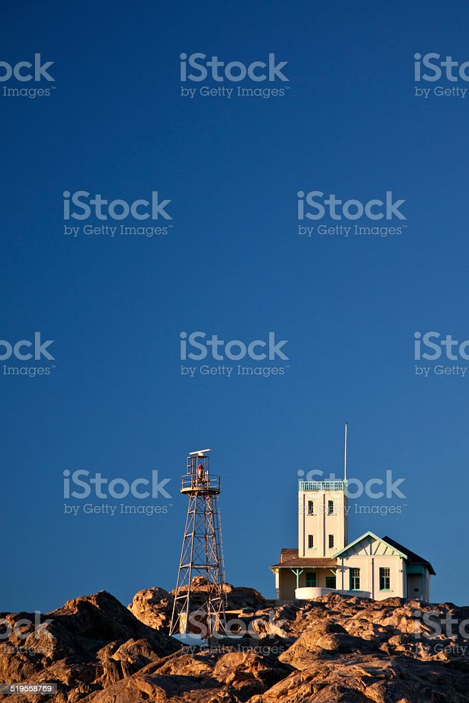 Lighthouse on a hill during the day stock photo