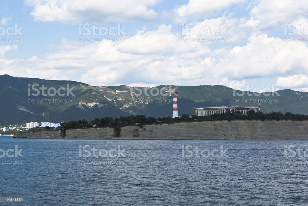 Lighthouse on a rocky shore Cape Tolstoy in resort Gelendzhik stock photo