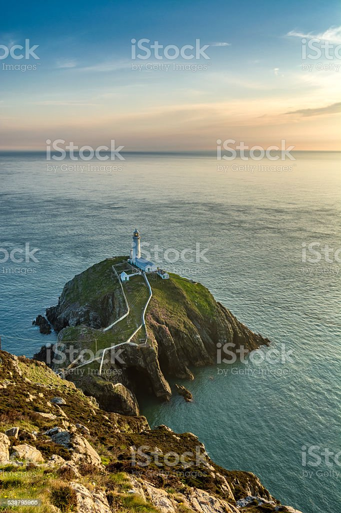 Lighthouse On An Island On The Coast Of North Wales. stock photo