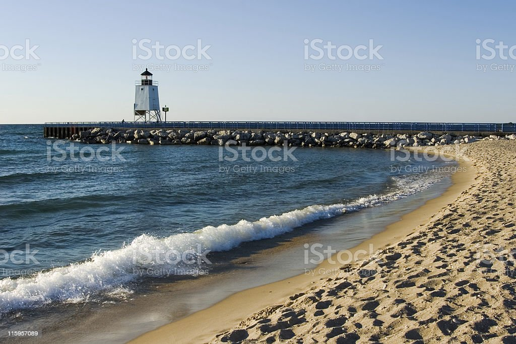 Lighthouse on Beach with Surf and Waves royalty-free stock photo