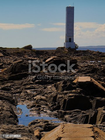 ITACARE, BAHIA  BRAZIL - lighthouse on Das Conchas beach, over black rocks discovered during low tide.