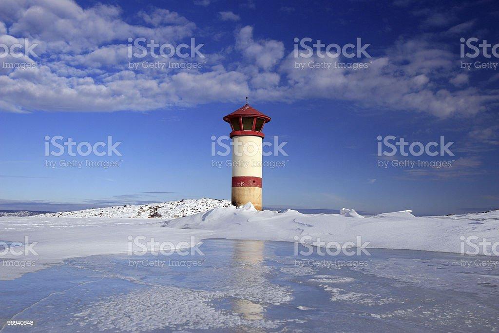 Lighthouse on ice royalty-free stock photo