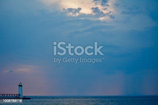 177362898istockphoto Lighthouse on Lake Michigan at sunset 1008789116