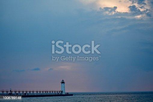 177362898istockphoto Lighthouse on Lake Michigan at sunset 1008789148