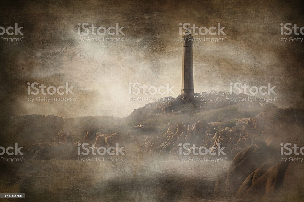 Lighthouse on rocky coast. Sepia toned and vintage stylized picture. royalty-free stock photo