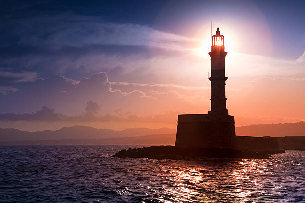 Lighthouse on sunset. Chania, Crete, Greece. Lighthouse on sunset. Chania, Crete, Greece. beacon stock pictures, royalty-free photos & images