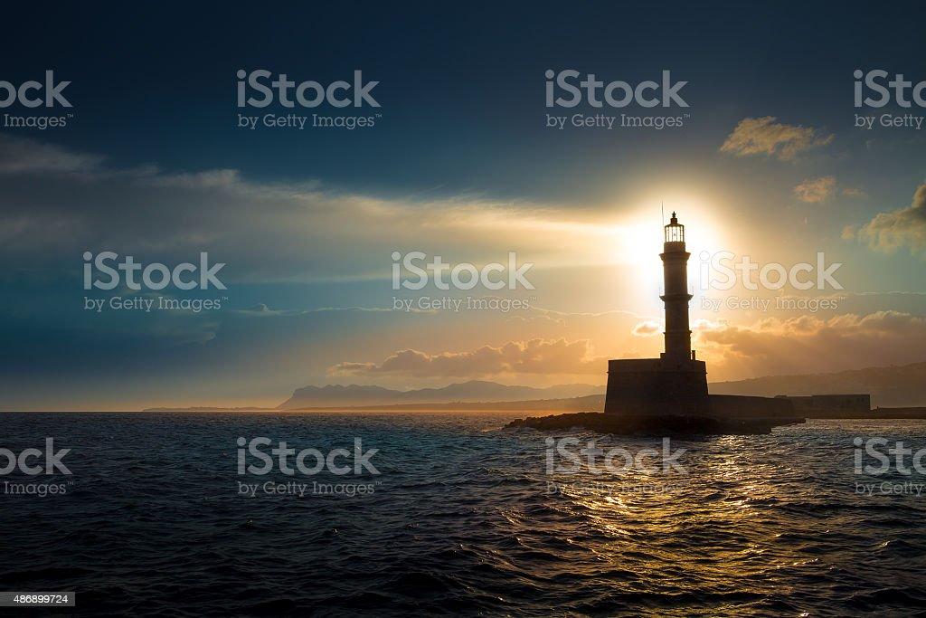 Great Lighthouse On Sunset. Stock Photo